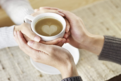 Hands holding coffee-resize.jpg